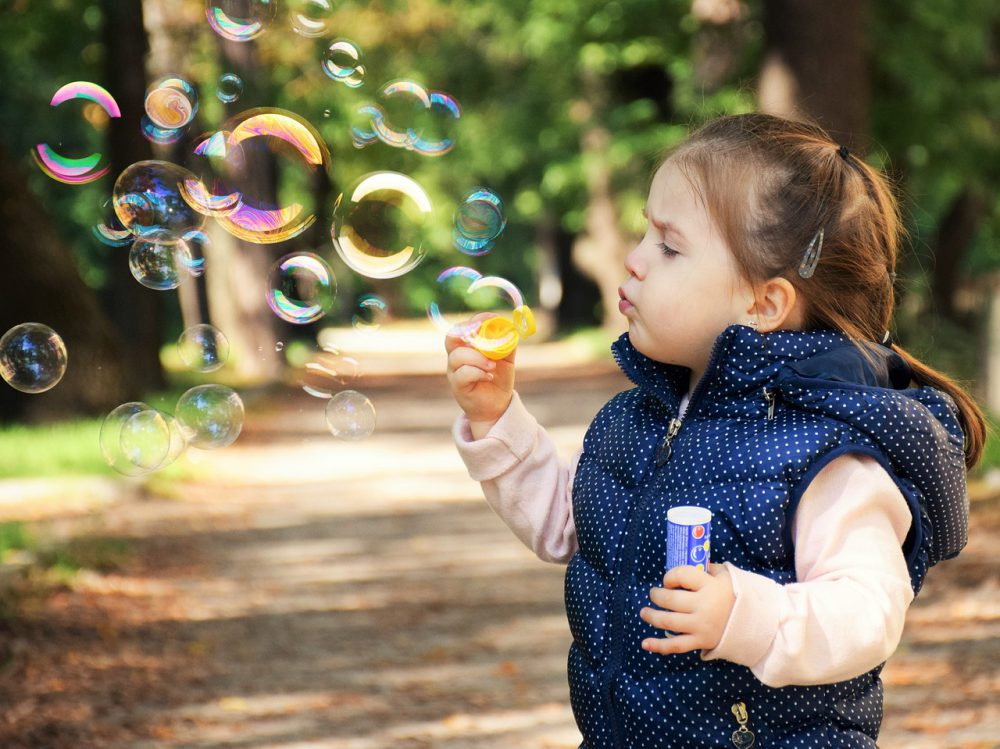 Kid Blowing Bubbles