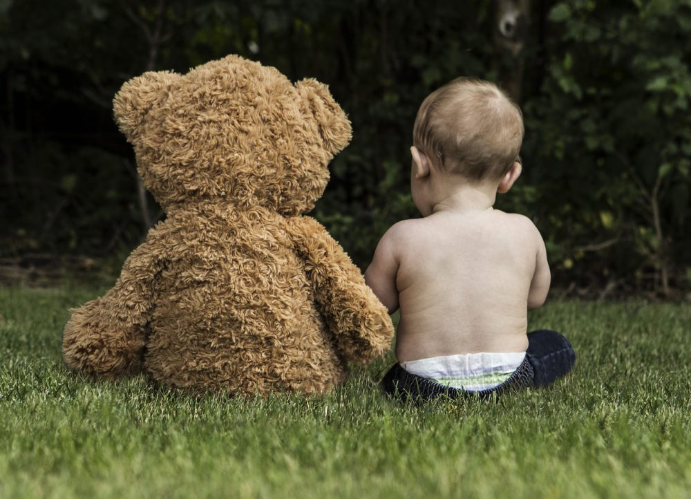 Kid with teddy bear